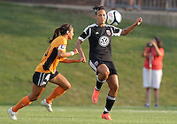 BOYDS, MARYLAND-JULY 07,2012:  Lianne Sanderson (10) of DC United Women goes for a high pass with Jen Agueci (14) of Dayton Dutch Lions during a W League game at Maryland Soccerplex, in Boyds, Maryland. DC United women won 4-1.