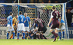 St Johnstone v Hearts.....18.01.14   SPFL<br /> Ref Brian Colvin tries to separate the players after Hearts second goal which led to Ryan Stevenson and Alan Mannus being sent off<br /> Picture by Graeme Hart.<br /> Copyright Perthshire Picture Agency<br /> Tel: 01738 623350  Mobile: 07990 594431