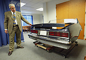 Fairfax County (Virginia) Police officer Bruce Guth shows a mock up of a Chevrolet Caprice used in court during the John Allen Muhammad trial in Virginia Beach Circuit Court in Virginia Beach, Virginia on November 7, 2003. <br /> Credit: Tracy Woodward - Pool via CNP