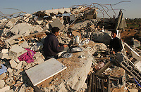 Al Zaytoun, Gaza. Brothers Feih and Ahmed Selmi, take a break as they try to rescue some goods from the rubble from what once was their family house in the neighborhood of Al Zaytoun in the outskirts of Gaza city, days after the military campaign, known as Operation Cast Lead, by the Israeli army. The Selmis, a family of five made their living farming vegetables for the local markets.  (PHOTO:  MIGUEL JUAREZ LUGO)