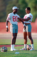 ROCKLIN, CA - Jerry Rice of the San Francisco 49ers and teammate Roger Craig stand together during training camp at Sierra College in Rocklin, California in 1988. Photo by Brad Mangin