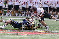 College Park, MD - April 1, 2017: Maryland Terrapins Jon Garino (12) fights for the faceoff during game between Michigan and Maryland at  Capital One Field at Maryland Stadium in College Park, MD.  (Photo by Elliott Brown/Media Images International)