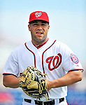 4 March 2012: Washington Nationals catcher Sandy Leon looks toward the dugout prior to a game against the Houston Astros at Space Coast Stadium in Viera, Florida. The Astros defeated the Nationals 10-2 in Grapefruit League action. Mandatory Credit: Ed Wolfstein Photo