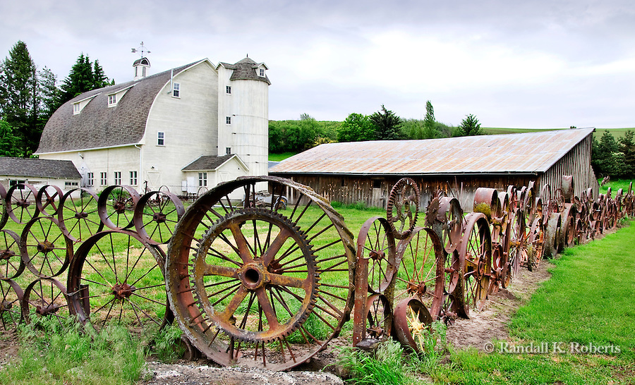 The Dahmen barn and wagon wheel fence, Uniontown, Washington, Palouse Country.  The fence is made from over 1,000 antique wagon and tractor wheels. The Dahmen barn was built in 1935 is now home to artists' space.