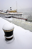 Kosuth boat in theice on the frozen Danube and winter snow. Budapest winter photos
