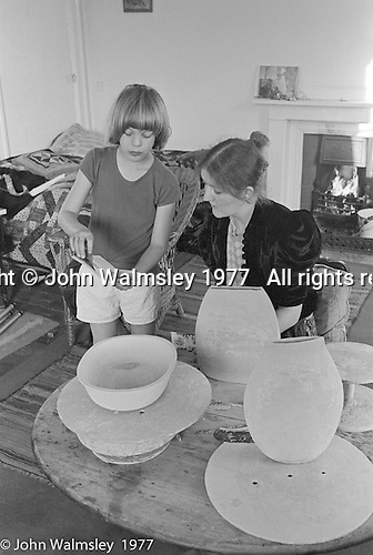 Liz Fritsch, potter, and son, Bertie.  Liz Fritsch lived and worked at Digswell House, an artists' community run by the Digswell Arts Trust, Welwyn Garden City, Hertfordshire, UK.  1977. Other artists there at the time included: Lol Coxhill, jazz saxophonist, Veryan Weston, jazz pianist, John Blakeley, sculptor, Patricia Leighton, sculptor and John Walmsley, photographer.