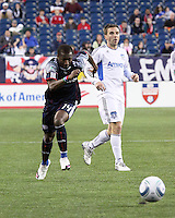 New England Revolution forward Sainey Nyassi (14) races to retrieve the ball won from San Jose Earthquakes midfielder Bobby Convey (11).  The New England Revolution and San Jose Earthquakes play to a scoreless draw at Gillette Stadium on May 15, 2010