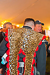Fund raiser for firefighter Ray Pfeifer on Saturday, March 31, 2012, at East Meadow Firefighters Benevolent Hall, New York, USA.Member of Boston Gaelic Fire Brigade Pipes and Drums band, which performed earlier, with faux leopard skin draped over uniform.