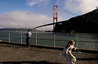 The pier at Fort Baker on the north side of the Golden Gate Bridge is a popular place for fishermen. Native species may be threatened by the number of invasive species being brought into the bay. <br /> A family from El Salvador sets lines and an excited Jessica dances and jumps with joy not able to contain her enthusiasm while watching her father and grandfather pull up their lines with fish hooked on them.