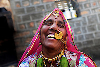 Sayeri devi in a light mood at her home wearing gold ornaments. Bisnois known to have affection for gold and it is also their status symbol as well as their investment. The design of the nose ring Sayari devi is wearing is a mark of being bishnoi. Jodhpur, Rajasthan, India. Arindam Mukherjee