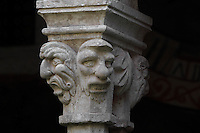 Capital with grotesque masks, atop pairs of 8-sided columns in the colonnade of the Cloister, built in late Romanesque style by Mihoje Brajkov of Bar in 1360, at the Franciscan monastery on Stradun or Placa, Old Town, Dubrovnik, Croatia. The city developed as an important port in the 15th and 16th centuries and has had a multicultural history, allied to the Romans, Ostrogoths, Byzantines, Ancona, Hungary and the Ottomans. In 1979 the city was listed as a UNESCO World Heritage Site. Picture by Manuel Cohen