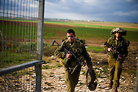 Kefar Azza, Israel, Jan 02, 2009.Israeli Paratroopers come back at dusk from a drill less than 2km from Gaza's border. After several weeks of total closure, Israel has launched its most important military operation ever in the Gaza strip, following Hamas' refusal to extend the 6 months truce.