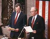 United States Vice President George H.W. Bush, left, and Speaker of the United States House of Representatives Jim Wright (Democrat of Texas), right, on the rostrum as they await the arrival of U.S. President Ronald Reagan to deliver his State of the Union Address in the U.S. Capitol in Washington, D.C. on January 25, 1988.<br /> Credit: Ron Sachs / CNP