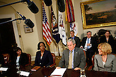 """WASHINGTON - OCTOBER 09:  (AFP OUT) U.S. President George W. Bush (2nd R) is joined by (L-R) Dianne Piche, Roslyn Brock and Ricki Sabia for a meeting on No Child Left Behind reauthorization in the Roosevelt Room at the White House Oct. 9, 2007 in Washington, DC. Bush met with leaders from the Citizens Commission on Civil Rights, Education Trust and other advocates for poor and minority children and urged the Congress to reauthorize the """"No Child Left Behind"""" legislation.  (Photo by Chip Somodevilla/Getty Images)"""