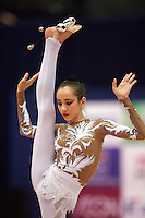 Daria Kushnerova of Ukraine begins clubs routine at 2006 Aeon Cup Worldwide Club Championships in rhythmic gymnastics on November 19, 2006 at Mie, Japan.  ..<br />