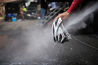 Marco Coledan (ITA/Trek-Segafredo) cleaning his helmet post-training<br /> <br /> preparing for the 108th Milano - Sanremo 2017<br /> (day before the race)