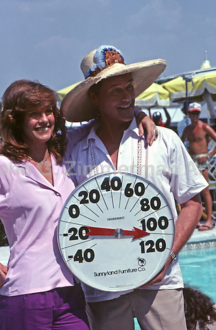 """Larry Hagman and Linda Gray on set of  """"Dallas,"""" South Fork Ranch, Texas, 1980."""