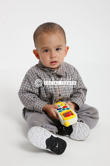 Studio portrait of small asian boy,