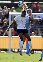 SAN DIEGO, CA - DECEMBER 02, 2012:  Kelly McFarlane (11) of the University of North Carolina goes up for a header with Maya Hayes (5) of Penn State University during the NCAA 2012 women's college championship match, at Torero Stadium, in San Diego, CA, on Sunday, December 02 2012. Carolina won 4-1.