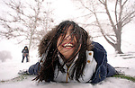 LOS ANGELES,CA - FEBRUARY 9,2009: Julissa Estrada is all smiles as she makes a face down snow angel during an outing to Lebec with her family from Bakersfield. Snow levels reaching down to 2500 feet February 9, 2009.