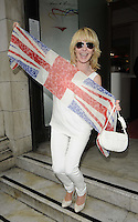 Lulu Kennedy-Cairns.The Prince Albert II of Monaco Olympians Reception, Old Burberry Building, Haymarket, London, England..August 9th, 2012.full length white trousers off the shoulder top purse bag union jack flag wrap sunglasses shades mouth open.CAP/CAN.©Can Nguyen/Capital Pictures.
