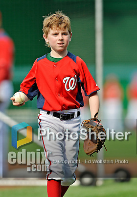 16 May 2012: Washington Nationals first baseman Adam LaRoche's 10-year old son Drake LaRoche helps out during batting practice prior to a game against the Pittsburgh Pirates at Nationals Park in Washington, DC. Adam notched his 1000th career hit and was named Player of the Game as the Nationals defeated the Pirates 7-4 in the first game of their 2-game series. Mandatory Credit: Ed Wolfstein Photo