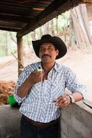 Felipe de Jesus Rios enjoying a mezcal at Felix Garcia´s ranch and distillery in El Potrero, Oaxaca, Oaxaca, Mexico