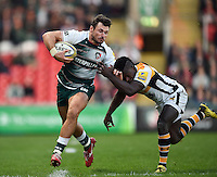Adam Thompstone of Leicester Tigers looks to fend Christian Wade of Wasps. Aviva Premiership match, between Leicester Tigers and Wasps on November 1, 2015 at Welford Road in Leicester, England. Photo by: Patrick Khachfe / Onside Images