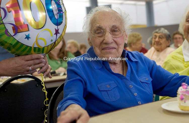 WATERBURY, CT. 05 April 2013-040813S07-Tessie Masie of Waterbury celebrates her 100th birthday with a cake and friends at the South Congregational Church in Waterbury Monday. Masi's birthday is April 11th..Steven Valenti Republican-American
