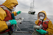 Crew from the Greenpeace ship Rainbow Warrior prepare to collect sea water samples to monitor radiation contamination levels, as the ship sails up the eastern coast of Japan, in the vicinity of Fukushima, in Japan, Tuesday 3rd May 2011.