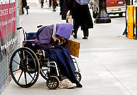Homeless people as seen on the streets of Chicago, Illinois. On This particular winter day, the temperature was about 15 degrees above zero. Temperature on this day was around 5 degrees above zero. This poor man sat out on the sidewalkd in his wheelchair outside Union Train Station in downtown Chicago for who knows how long.