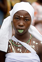 Ordered to keep silent for the last steps of the puberty rites - locally called dipo - a girl from the Krobo tribal group holds a leaf in her mouth - this will ensure she doesn't utter a word.