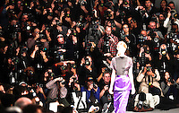 New york, United States. 7th February 2013 -- Photographers take pictures of a model displaying a creation by American fashion designer Richard Chai during New York Fashion Week 2013 in New York. Photo by Kena Betancur / VIEWpress.