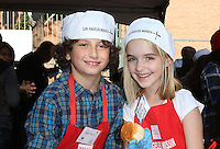 Los Angeles, CA - NOVEMBER 23: August Maturo, Mckenna Grace, At Los Angeles Mission Thanksgiving Meal For The Homeless At Los Angeles Mission, California on November 23, 2016. Credit: Faye Sadou/MediaPunch