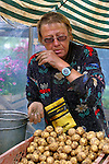 Europe, Latvia, Riga. A Latvian potato farmer markets her spuds at the Riga Market.