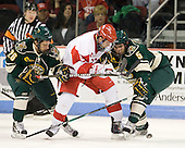 Brett Leonard (Vermont - 26), Joe Pereira (BU - 6), Arthur Griem (Vermont - 5) - The visiting University of Vermont Catamounts tied the Boston University Terriers 3-3 in the opening game of their weekend series at Agganis Arena in Boston, Massachusetts, on Friday, February 25, 2011.