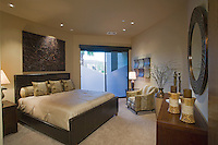 Luxurious bedroom shown with daylight through frosted glass window