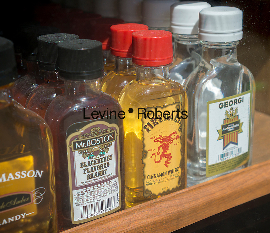 Pint bottles of the popular Fireball Cinnamon Whiskey with other liquor in the window of a liquor store in New York on Saturday, April 16, 2016.  (© Richard B. Levine)
