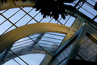Tropical Rainforest Glasshouse (formerly Le Jardin d'Hiver or Winter Gardens), 1936, René Berger, Jardin des Plantes, Museum National d'Histoire Naturelle, Paris, France. Low angle view of the glass and metal stucture from inside the main Art Deco style entrance.