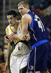 Dallas Mavericks' Dirk Nowitzki (R) blocks Seattle SuperSonics' Nick Collison out of the play in the first period of their game at the Key Arena in Seattle, Washington Wednesday, 13 April  2005.. Jim Bryant Photo. &copy;2010. All Rights Reserved.