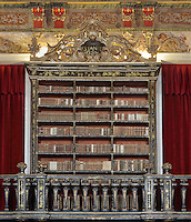 Green Room, with bookcases with Chinese motifs, lacquer and gilding by Manuel da Silva, in the Joanina Library, or Biblioteca Joanina, a Baroque library built 1717-28 by Gaspar Ferreira, part of the University of Coimbra General Library, in Coimbra, Portugal. Through the archway is the Red Room, then the Black Room, with the portrait of King John V or Joao V, 1689-1750, by Domenico Dupra, 1725, in the distance. The Casa da Livraria was built during the reign of King John V or Joao V, and consists of the Green Room, Red Room and Black Room, with 250,000 books dating from the 16th - 18th centuries. The library is part of the Faculty of Law and the University is housed in the buildings of the Royal Palace of Coimbra. The building is classified as a national monument and UNESCO World Heritage Site. Picture by Manuel Cohen