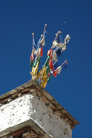 Prayer flags fly above a house in Tibet. The custom of flag hoisting dates back to several thousand years. It was found within the nomadic (drogpa) communities and they used to hoist flags to ensure good fortune, luck and prosperity.