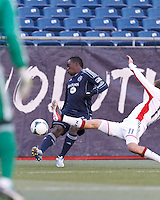 Sporting Kansas City defender Mechack Jerome (24) crosses the ball. In a Major League Soccer (MLS) match, Sporting Kansas City (blue) tied the New England Revolution (white), 0-0, at Gillette Stadium on March 23, 2013.