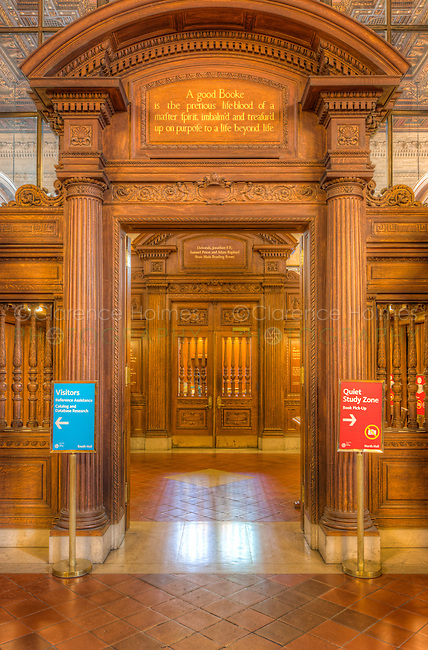 """The entrance to the Rose Main Reading Room in the main branch of the New York Public Library in New York City.  The quotation above the door is from John Milton's Areopagitica and reads """"A good Booke is the pretious lifeblood of a master spirit, embalm'd and treasur'd up on purpose to a life beyond life"""" [sic]."""