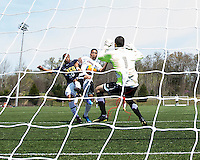 The UNC Greensboro Spartans played the University of South Carolina Gamecocks in The Manchester Cup on April 5, 2014.  The teams played to a 0-0 tie.  Davis Griffin (1), Justin Jones (20), Asa Kryst (7)