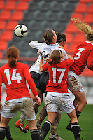 Abby Wambach and Carli Lloyd collide with several Norwegian defenders.  The USA defeated Norway 2-1 at Olhao Stadium on February 26, 2010 at the Algarve Cup.