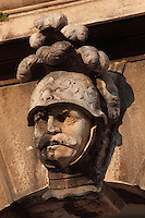 Carved soldier's head with plumed lion helmet, on the archway next to the Bell Tower on Luza Square on Stradun or Placa, the main street in the Old Town, Dubrovnik, Croatia. The city developed as an important port in the 15th and 16th centuries and has had a multicultural history, allied to the Romans, Ostrogoths, Byzantines, Ancona, Hungary and the Ottomans. In 1979 the city was listed as a UNESCO World Heritage Site. Picture by Manuel Cohen