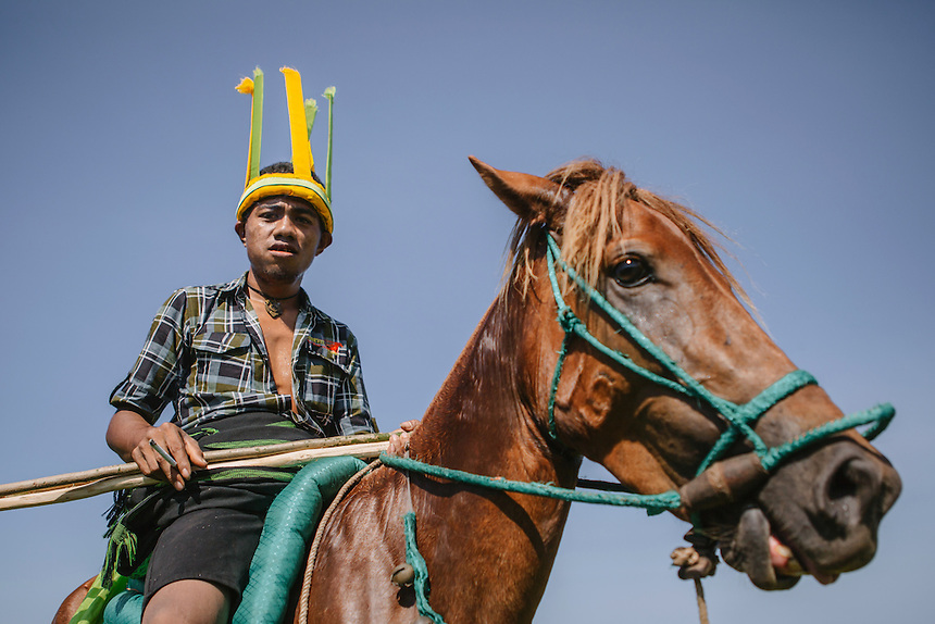 Portrait of a Pasola warrior during the event in Homba Kalayo, Kodi. Pasola is an ancient tradition from the Indonesian island of Sumba. Categorized as both extreme traditional sport and ritual, Pasola is an annual mock horse warfare performed in response to the harvesting season. In the battelfield, the Pasola warriors use blunt spears as their weapon. However, fatal accident still do occurs.