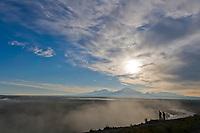 Mount Sanford, Mount Drum and Mount Wrangell of the Wrangell mountains, Wrangell St. Elias National Park, Alaska. Morning fog on the Copper River.