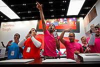 Microsoft workers cheer at the entrance of the store while customers arrive during the opening of Microsoft's store at Times Square in New York, October 25, 2012. . Photo by Eduardo Munoz Alvarez / VIEW.